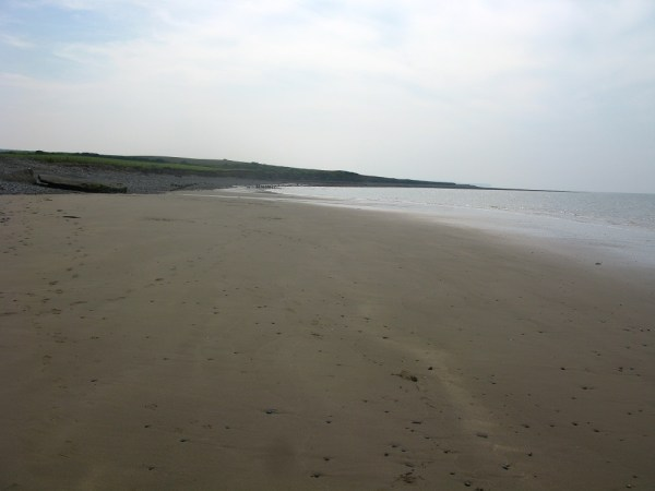 Llanrhystud beach at low tide exposing the sands and rock pools