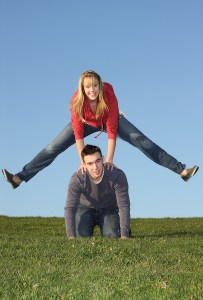 Cute young couple playing leapfrog.