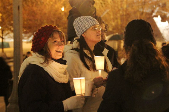 Christmas Caroling at the Bean by candlelight