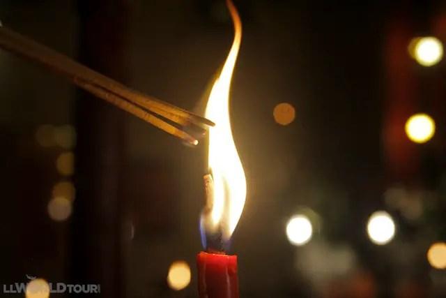 Lighting Incense at Man Mo Temple in Hong Kong
