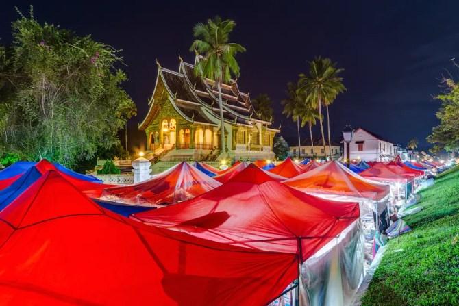 Tents of night market and Royal Palace in Luang Prabang, Laos