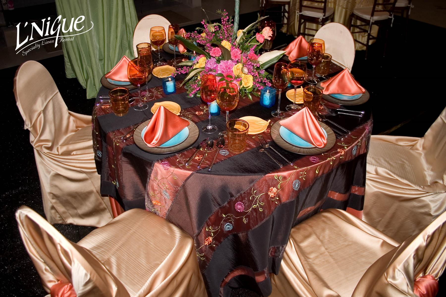 chair covers rental cleveland ohio humanscale world satin papaya tablecloth specialty linen