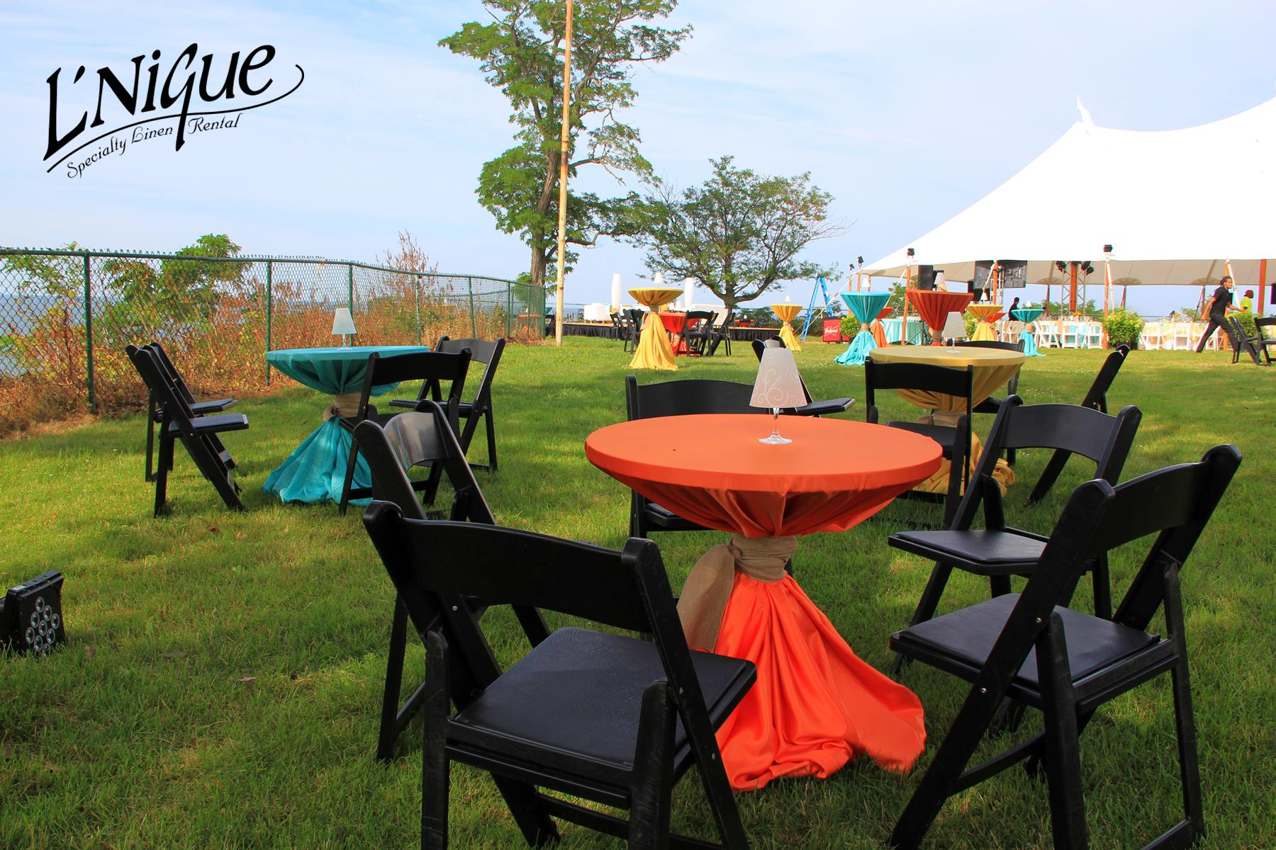 chair covers rental cleveland ohio grosfillex resin chairs majestic orange tablecloth specialty linen