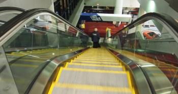 woman on escalator