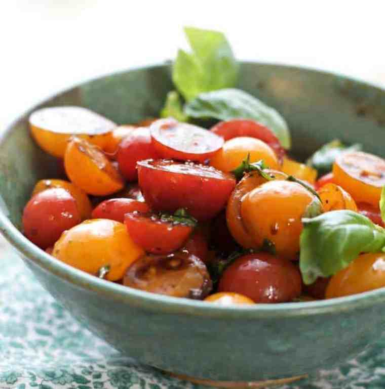 Delicious summer cherry tomatoes in a green bowl for how to peel and seed a tomato