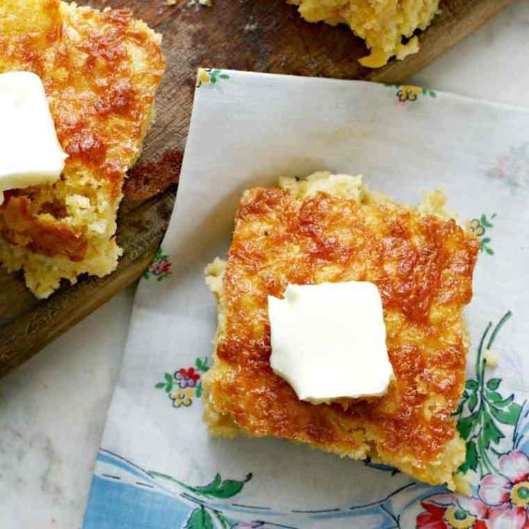 Southern Mexican Cornbread with a cute floral napkin beneath and butter on top