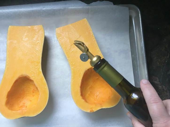 a photo of the squash with oil being drizzeled over for Roasted Butternut Squash Soup