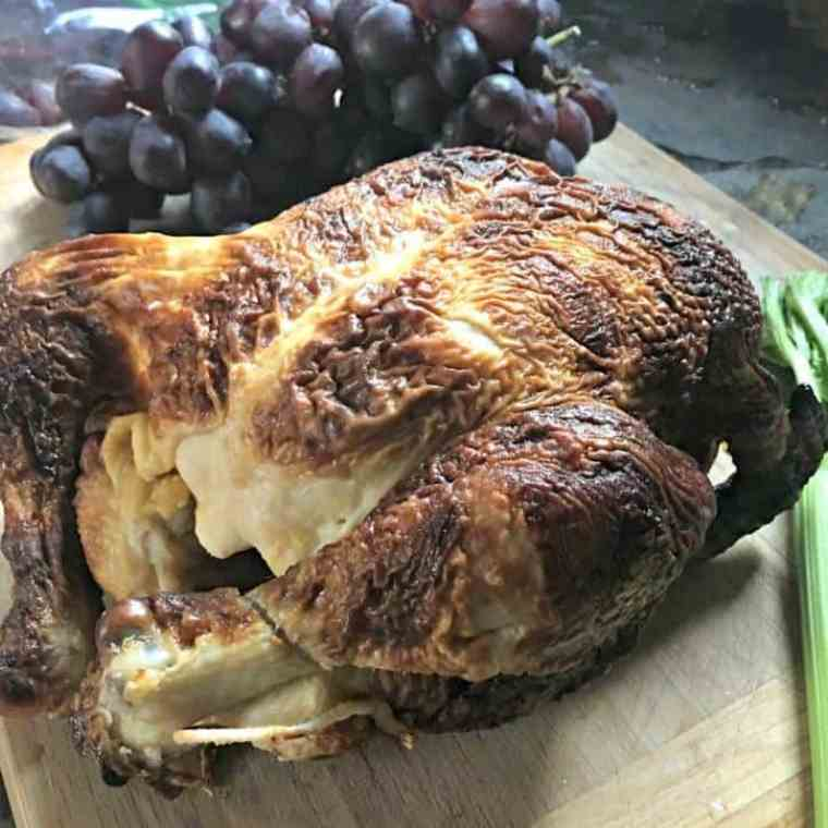 A photo of the rotisserie chicken, purple grapes and a celery stalk for easy rotisserie chicken salad