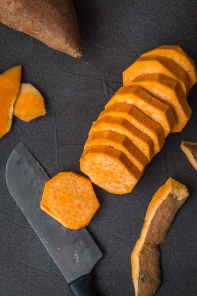 Cut sweet potatoes for sweet potato cobbler