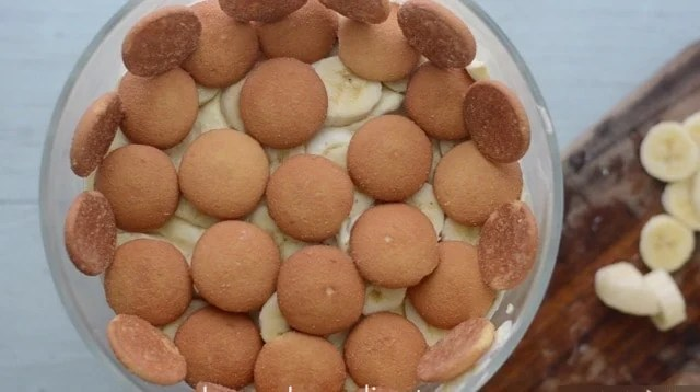 Vanilla Wafters layered on the top of a bowl of banana pudding