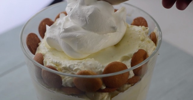 Cool whip being spread on the top of mawmaws banana pudding