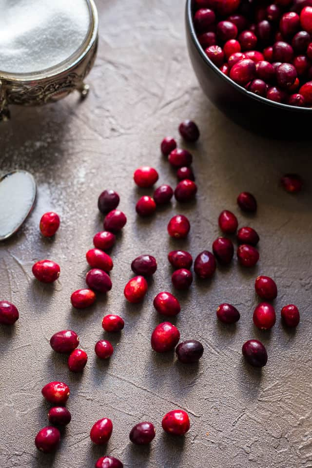Fresh cranberries with white sugar bowl
