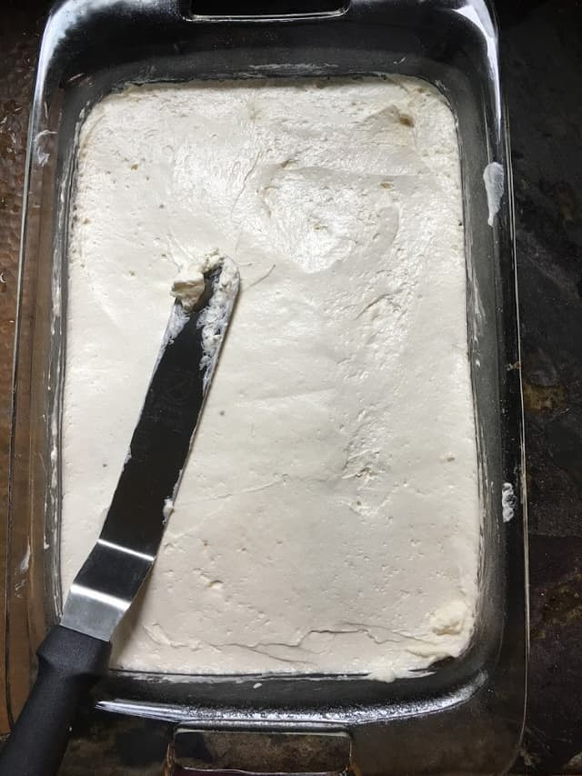 Cool whip mixture spread out smooth on top of the crust in a 9x13 pan