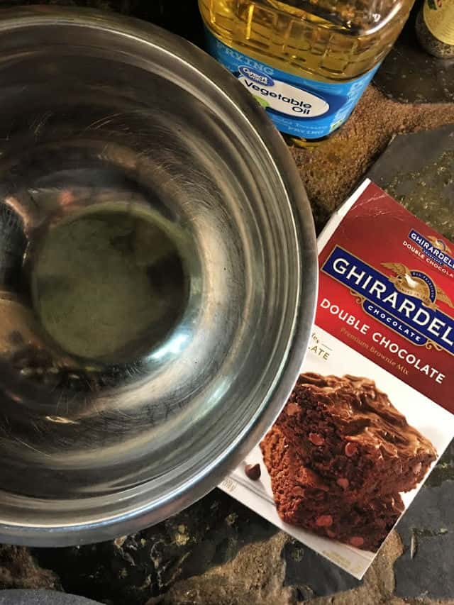 empty silver bowl with box of brownie mix