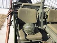 M1 rifle in scabbard (on the left), WW II era helmet on the passenger seat