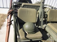 M1 rifle in scabbard (on the left), WW II era helmet on the passenger seat