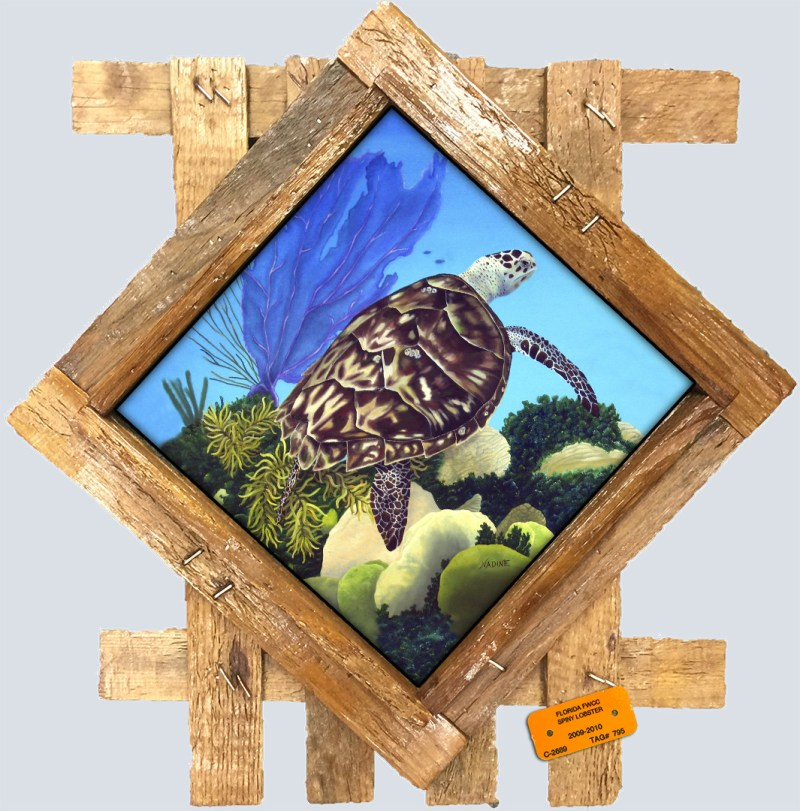 painting of a turtle on a reef printed on a ceramic tile and placed in a diamond shaped lobster trap lid frame