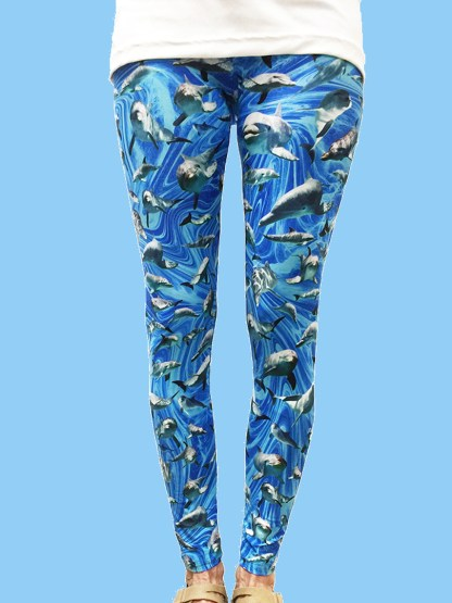 ladies leggings with a blue ocean swirl background with numerous dolphin photos