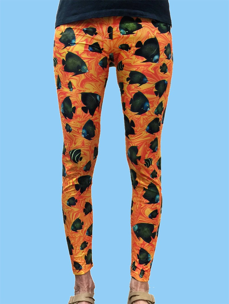 ladies leggings with french angelfish over a very colorful orange swirl background