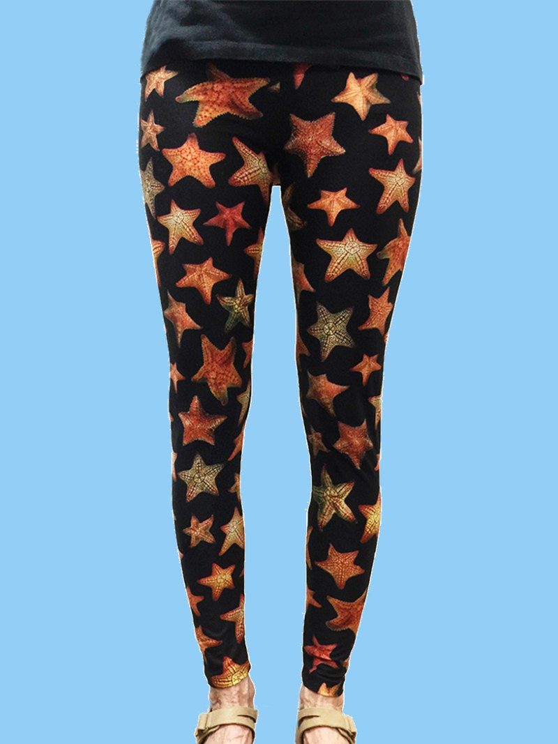 ladies leggings black background with numerous starfish photos
