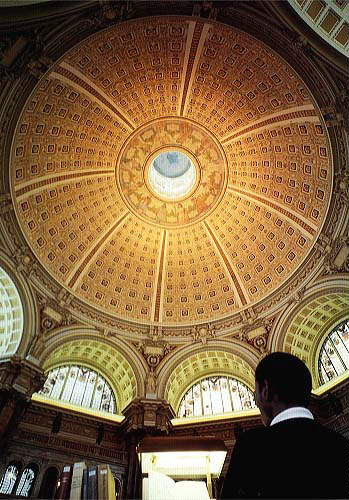 A researcher stands under the dome of the Main Reading Room of the Jefferson Building