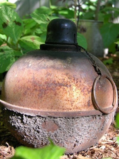 An antique torch adds a touch of nostalgia to the garden.