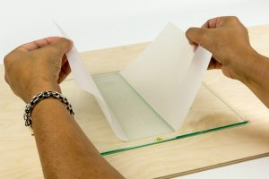 Applying the adhesion sheet