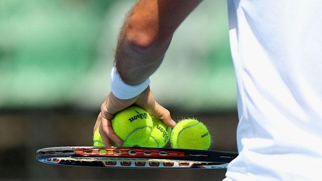 tennis balls on racquet_3661502201877721-159532