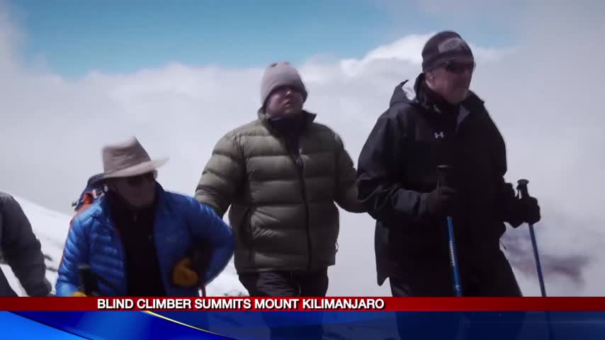 Blind CNY climber summits Mt- Kilimanjaro_32691031