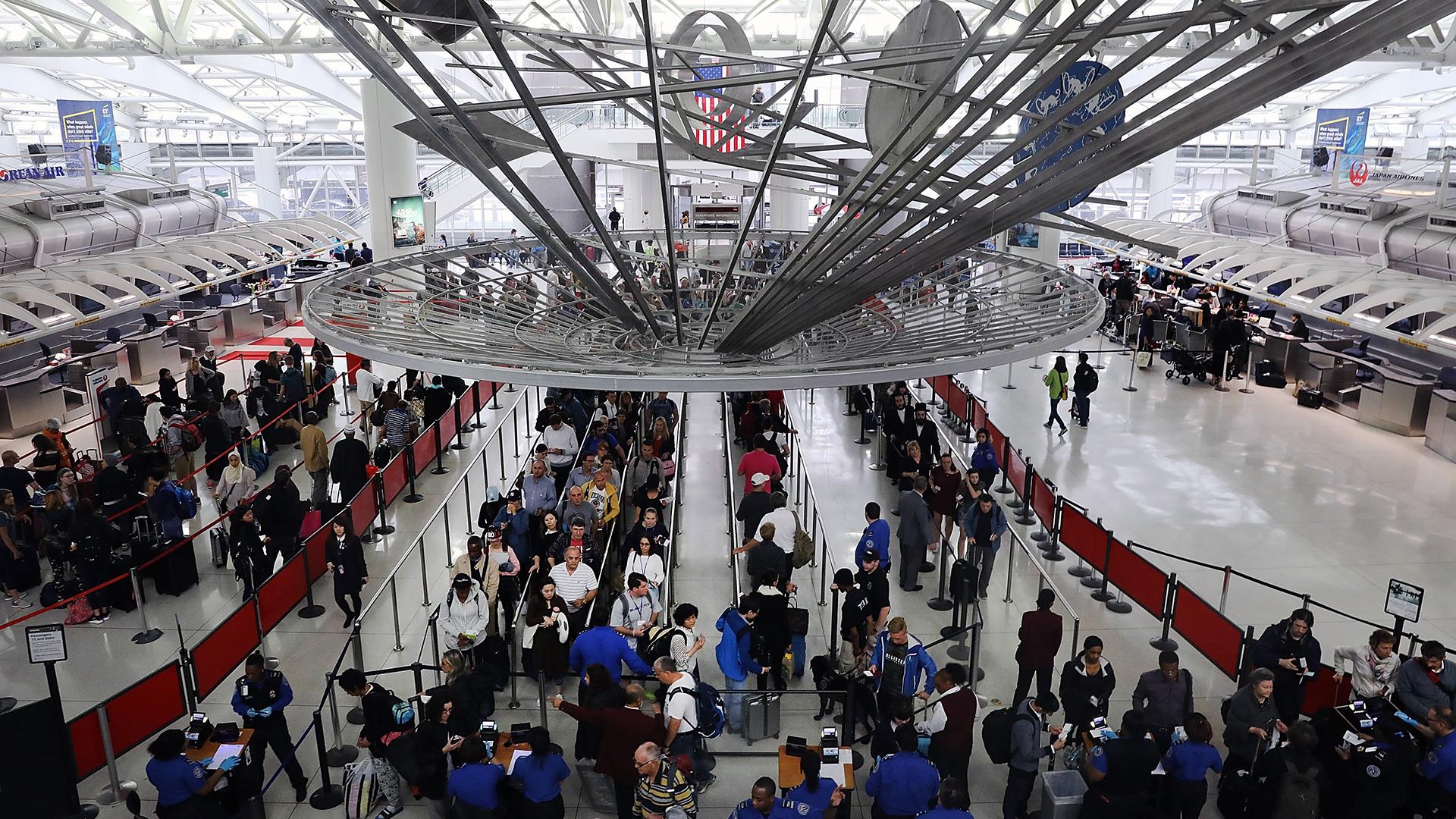 Travelers in line at JFK Airport-159532.jpg87486269