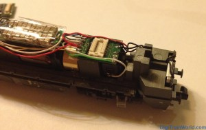 Vossloh G2000 Next 18 DCC conversion: Next18 adapter in place and soldered