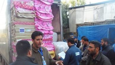 Medewerkers van Oxfam verdelen hulpgoederen in Gaza