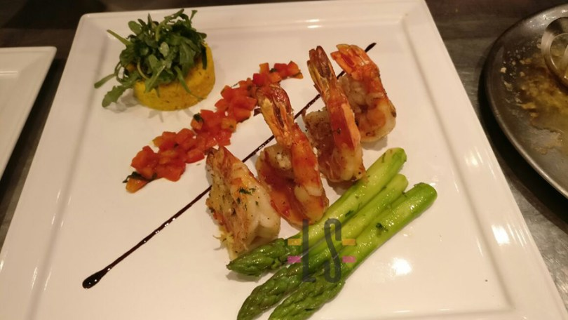 Ocean fresh Grilled jumbo prawns with red pepper compote,Peruvian Asparagus napped with garli and parsley butter