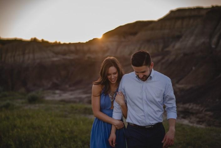 drumheller engagement photography couple sunset walking
