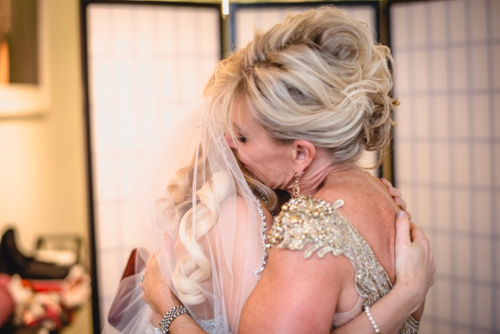 bride and mother hug