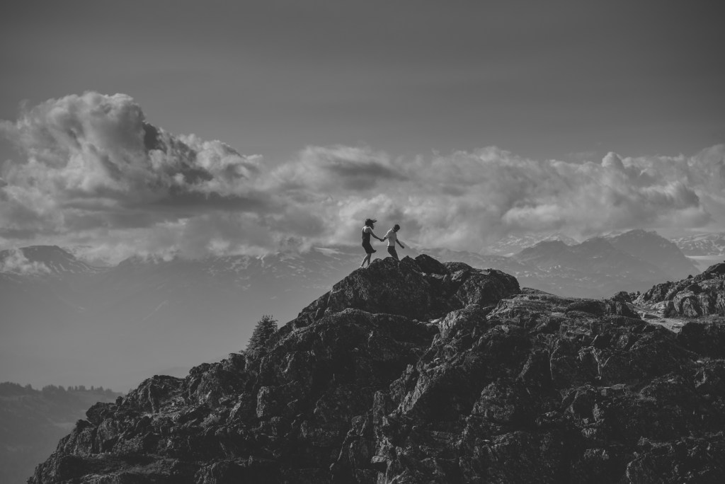 A couple walking on the peak of Whistler Blackcomb