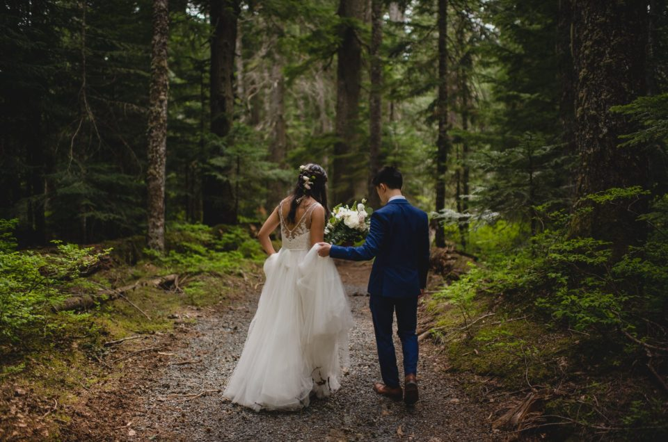 bride groom walking through forest whistler