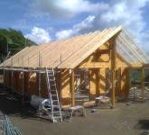 Delivery and construction of log house with planning permission for wind turbine