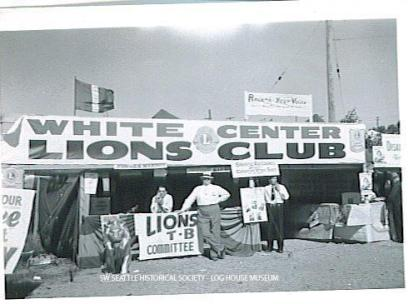 Elie LeDuc and Ernie Wolfe at the White Center Lions Club booth during the Mardi Gras festival in White Center, September 1948 SWSHS 2005.001.0396-AB