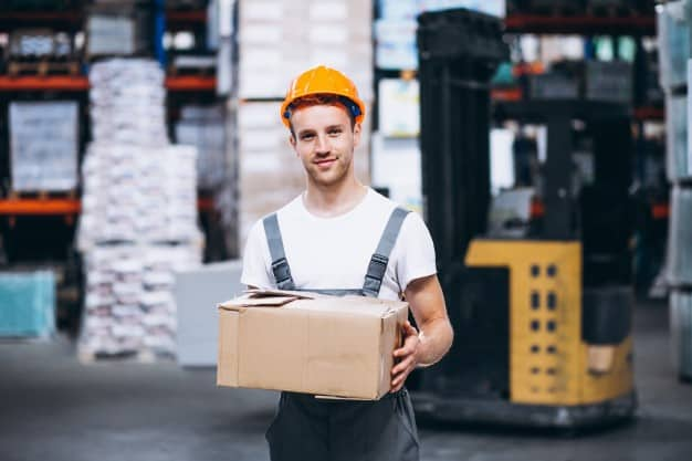A young man working in a warehouse