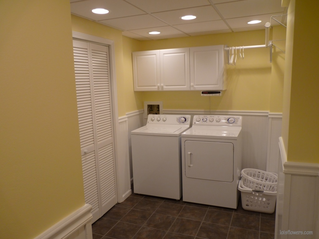 lighting for laundry room. the size of our basement laundry room is about 100 square feet or so my husband tells me when he first said how many lights wanted to install lighting for r