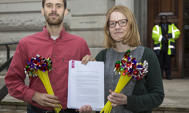 Campaigners from climate change charity 10:10 took bouquets of pinwheels to the Treasury along with a petition signed by just under 18,000 wind power supporters. (Photograph: Andrew Aitchison )