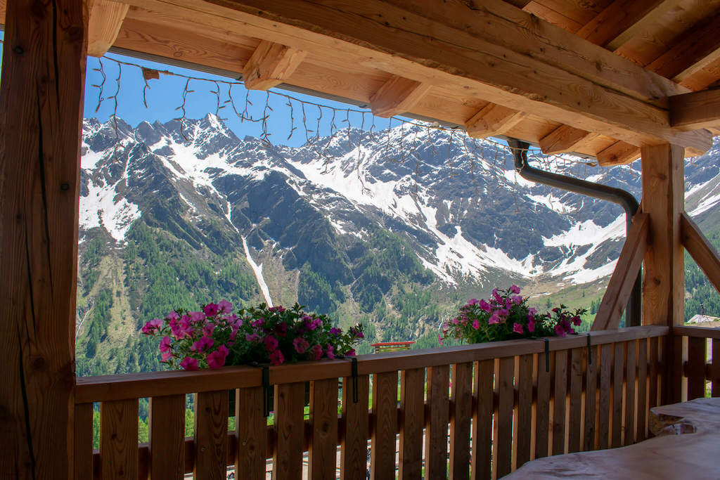Visit Trentino Italy - alpine hut at the top of a mountain