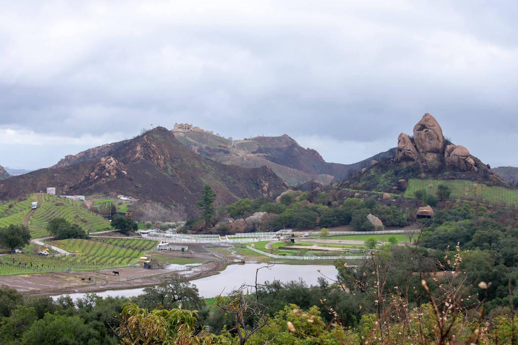 Areas of LA - Malibu on a rainy day with mountains, a lake and a farm