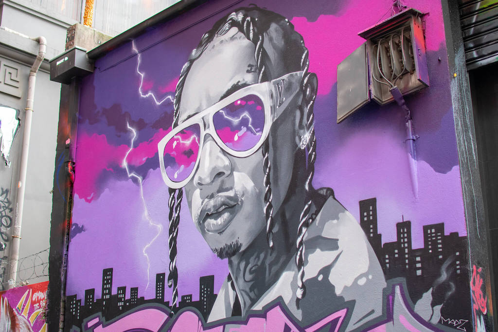 Melbourne Street Art Mural, Man wearing sunglasses with purple background and city skyline