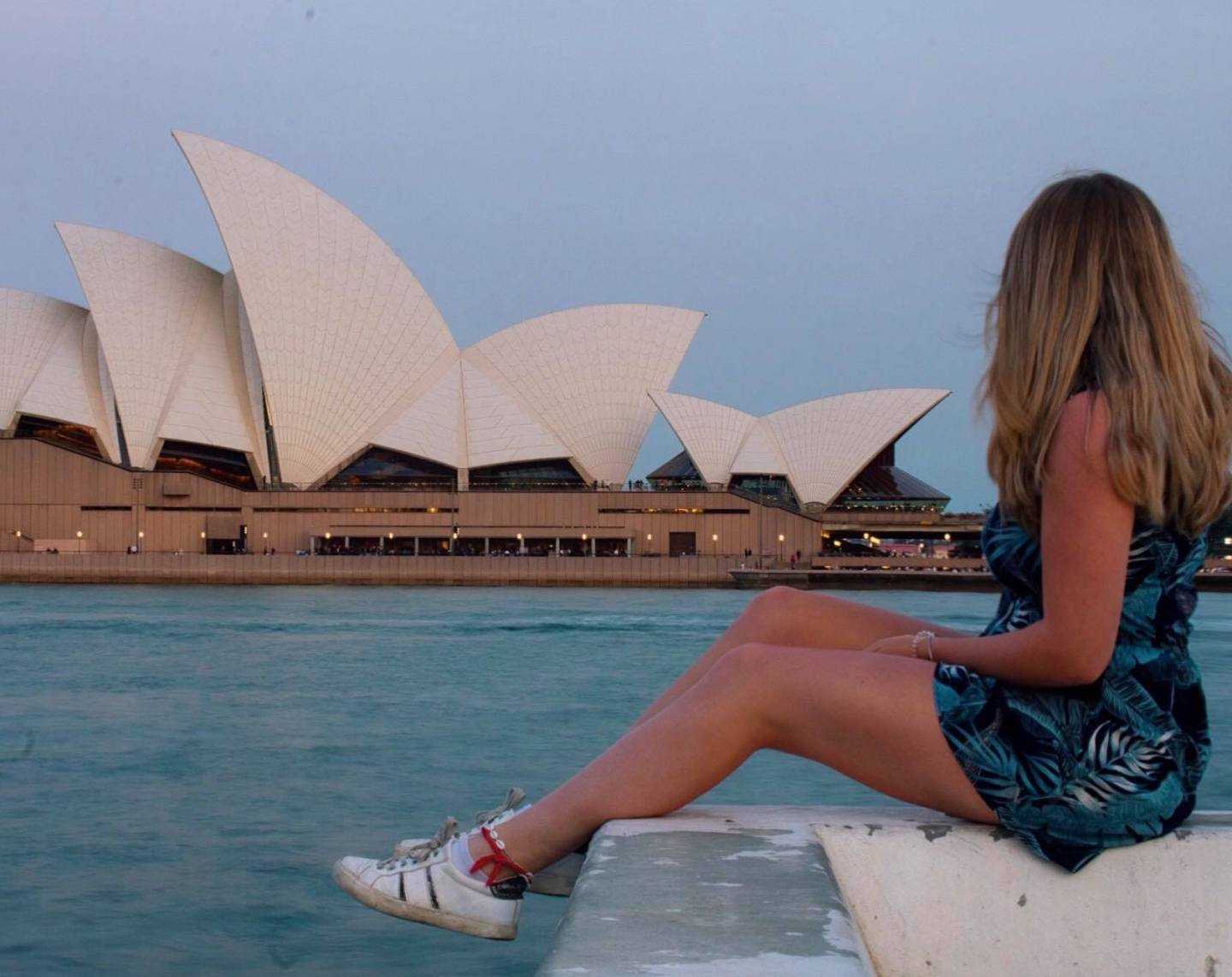 Girl sat in front of Sydney Opera House