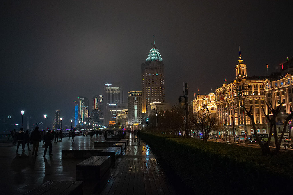 View down the Bund in Shanghai, colonial-era buildings with modern skyscrapers behind
