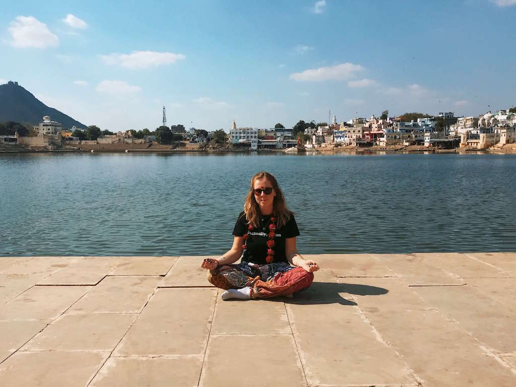 Girl meditating by the holy lake in Pushkar, North India
