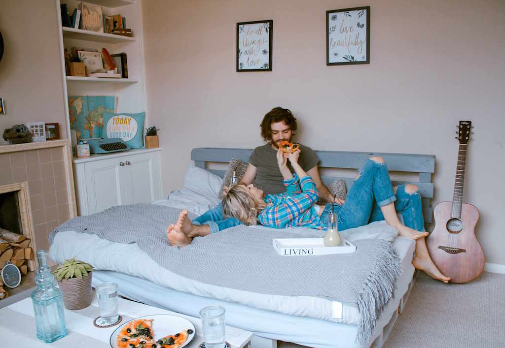 At home date ideas, couple on sofa