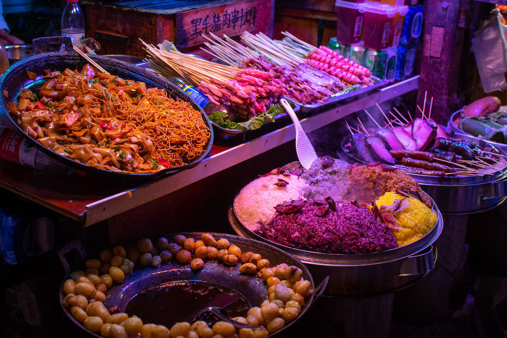 Lots of different dishes at a street food stall in China